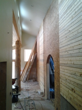 Entry Hall with Beetle Kill paneling, brick coming soon